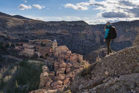 A hiker admires the view of Albarracin. Albarracin, Teruel, Aragon, Spain