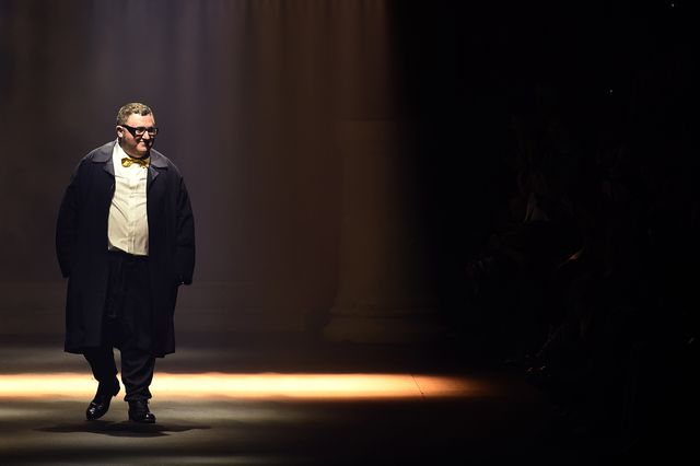 moroccan born israeli designer alber elbaz acknowledges the public at the end of the lanvin's 2016 springsummer ready to wear collection fashion show, on october 1, 2015 in paris  afp photo  miguel medina photo by miguel medina  afp photo by miguel medinaafp via getty images