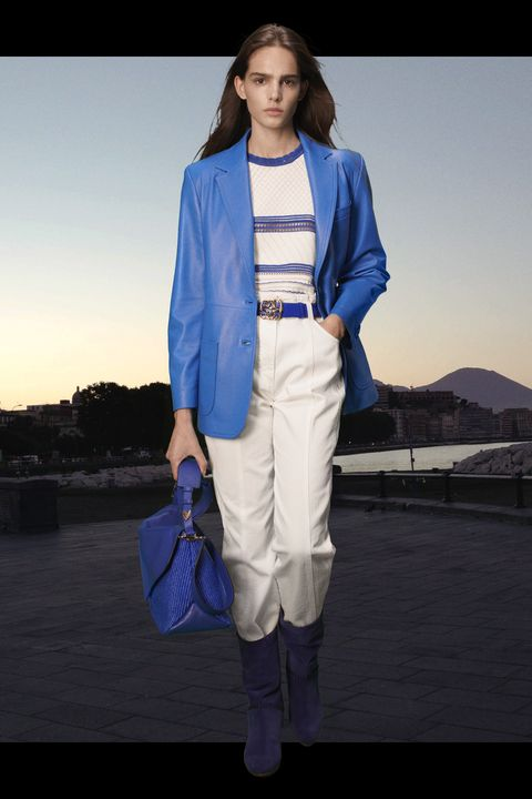 model in blue blazer and white pants