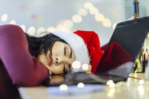 blacking out from alcohol a japanese drunk young woman is sleeping in front of computer on christmas