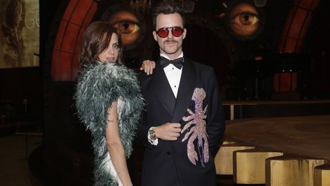 Suit, Formal wear, Fashion, Fun, Tuxedo, Event, Glasses, Fictional character, Vision care, Performance,