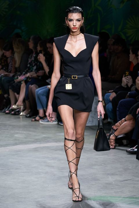 Fashion show, Fashion model, Fashion, Runway, Clothing, Thigh, Dress, Shoulder, Fashion design, Leg,