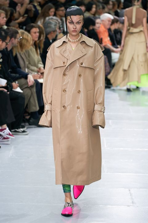 Fashion, Fashion show, Runway, Fashion model, Clothing, Outerwear, Coat, Trench coat, Human, Overcoat,