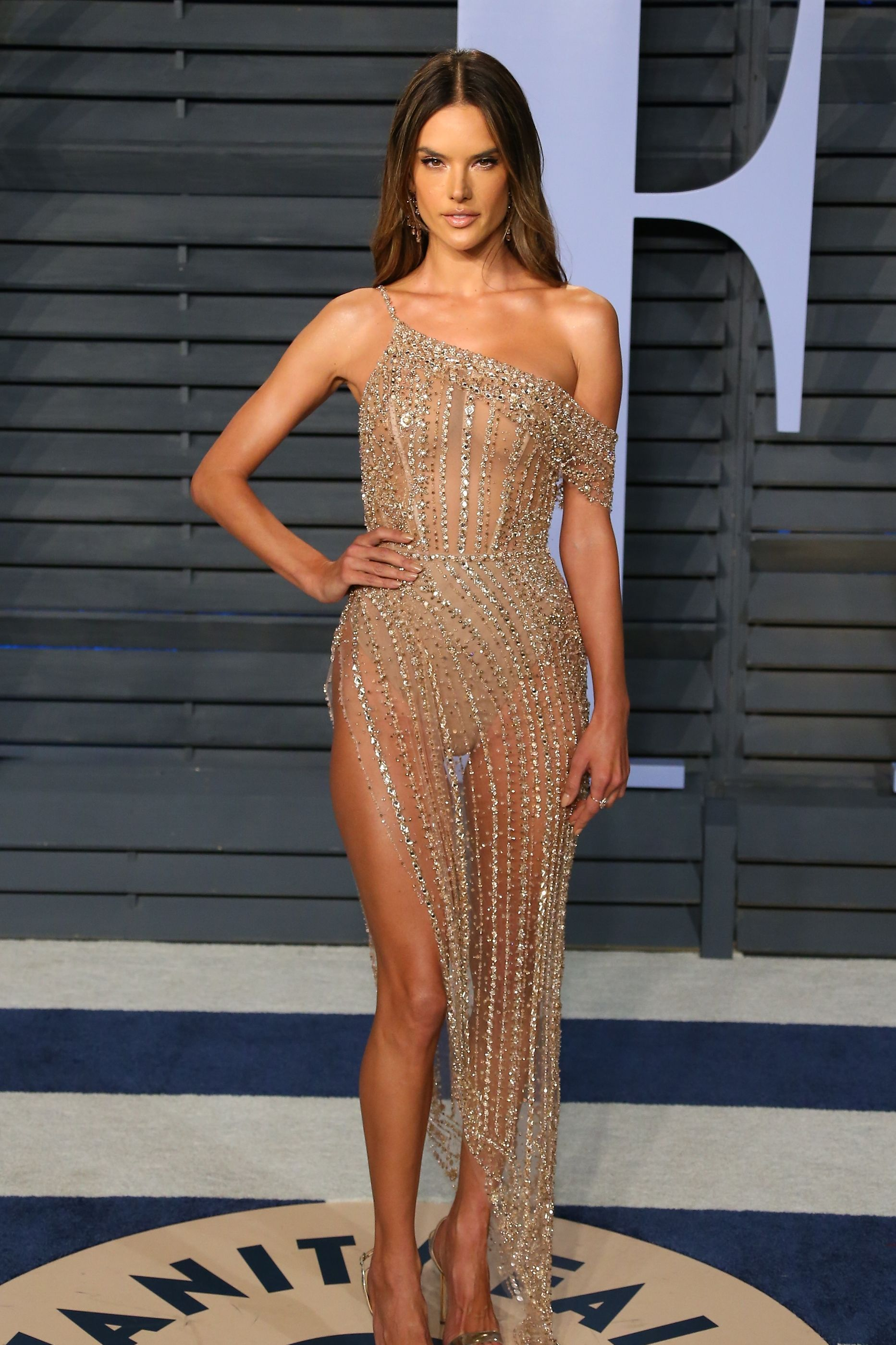 Alessandra Ambrosio The model arrived at Vanity Fair's Oscars after-party in 2018 wearing a bejeweled Ralph & Russo dress with Giuseppe Zanotti shoes and Lorraine Schwartz jewelry. There's no secret she killed it in this naked dress.