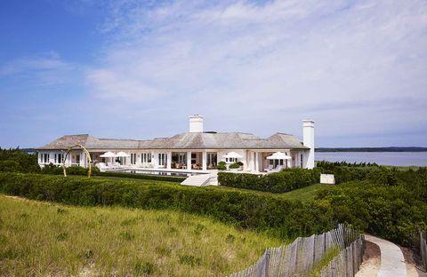 cedar shingles crown a stucco residence on the ocean