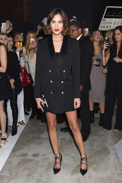 Fashion model, Fashion, Fashion show, Clothing, Event, Little black dress, Runway, Dress, Public event, Shoulder,