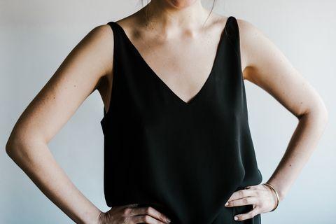 Black, Clothing, Shoulder, Neck, Dress, Fashion, Arm, Leotard, Sleeveless shirt, Joint,