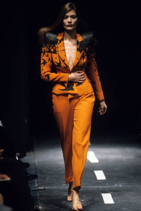 Fashion model, Fashion, Fashion show, Runway, Clothing, Orange, Suit, Fashion design, Yellow, Pantsuit,