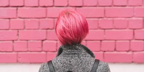 Hair, Pink, Red, Wall, Shoulder, Hairstyle, Outerwear, Neck, Street fashion, Pattern,