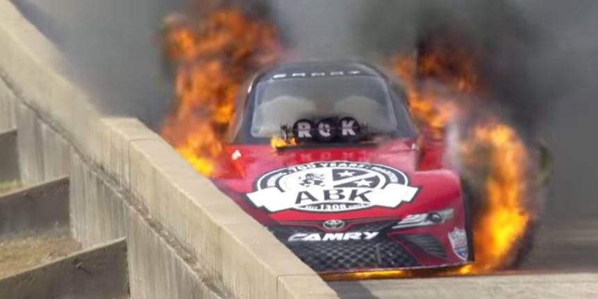 Watch this incredible escape from a massive NHRA fireball