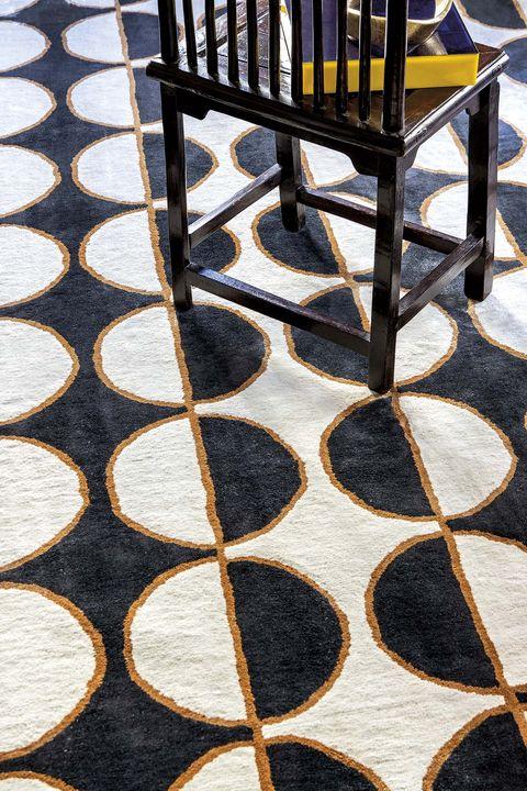 alfombra en semi círculos de fabián Ñíguez para kaymanta