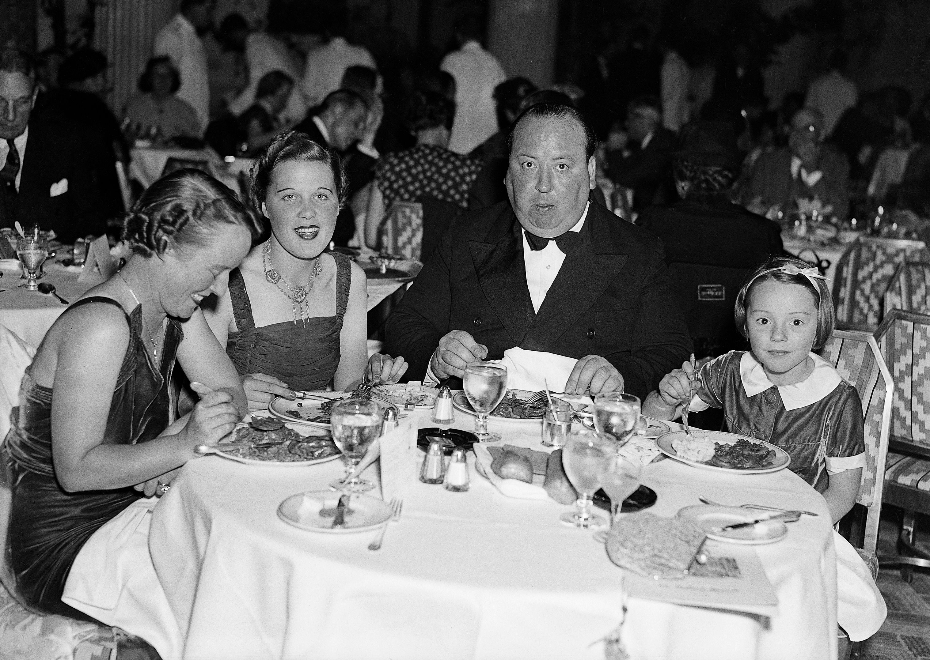 L-R: Alma Reville, Joan Harrison, Hitch and daughter Pat in a New York restaurant, August 1937