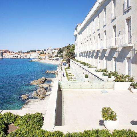 Property, Sea, Coast, Architecture, Town, Azure, Building, Vacation, Tourism, Coastal and oceanic landforms,