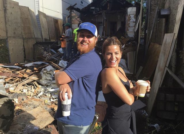 donovan eckhardt and alison victoria standing back to back holding coffee