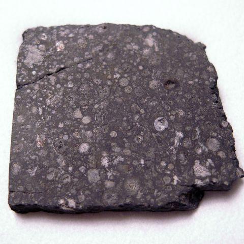 Rock, Mineral, Igneous rock, Geology, Graphite, Volcanic rock, Metal, Meteoroid,