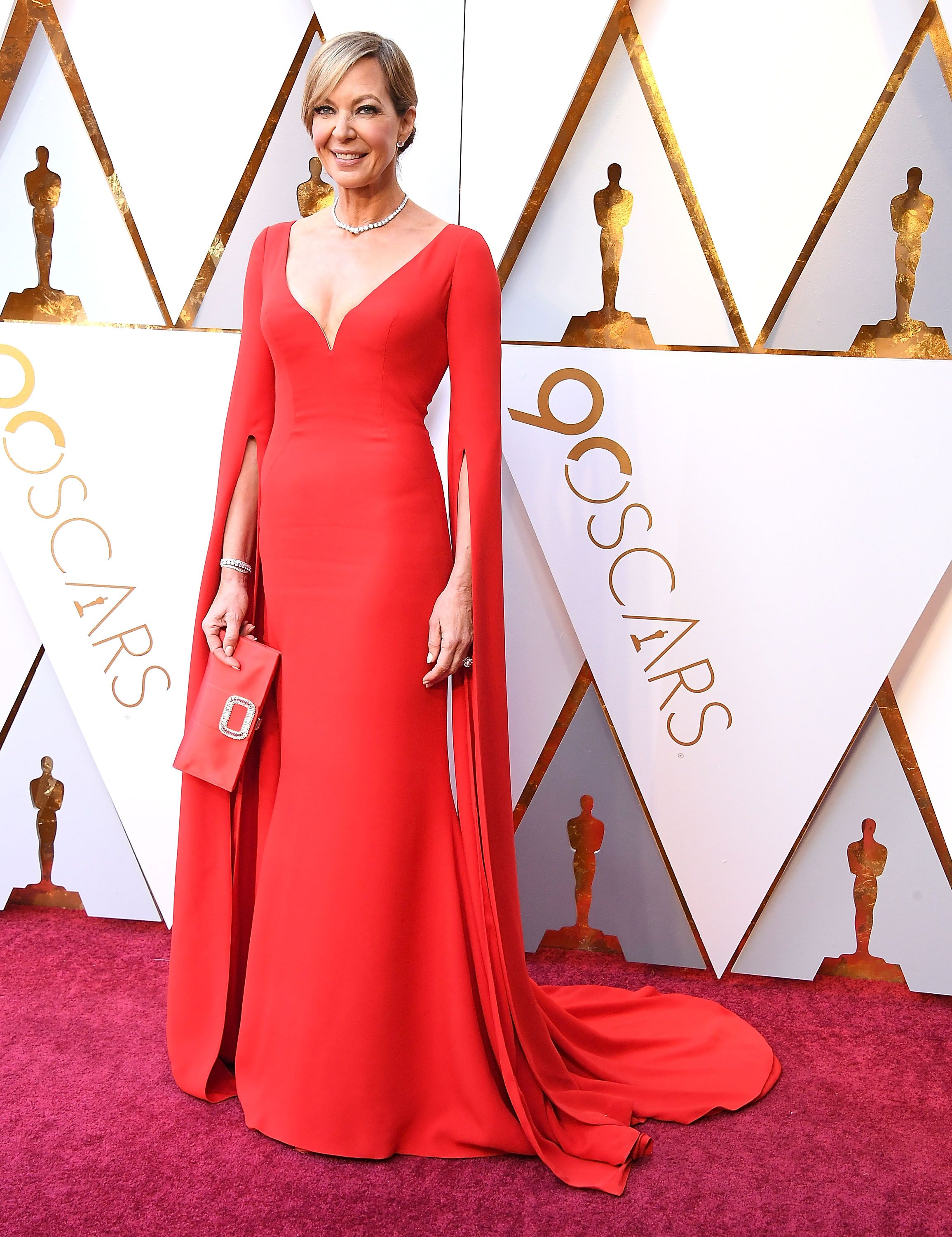 Janney picked a vivid red Reem Acra gown with a plunging neckline and extra-long sleeves for the 2018 Academy Awards—proof that the subtle details make the dress.