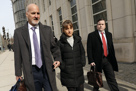 actress allison mack leaves the brooklyn federal courthouse with her lawyers after a court appearance surrounding the alleged sex cult nxivm on february 06, 2019 in new york city