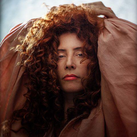 Hair, Face, Beauty, Head, Hairstyle, Lip, Eye, Long hair, Portrait, Red hair,