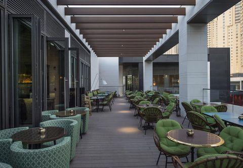 Architecture, Interior design, Furniture, Table, Real estate, Ceiling, Design, Apartment, Commercial building, Houseplant,