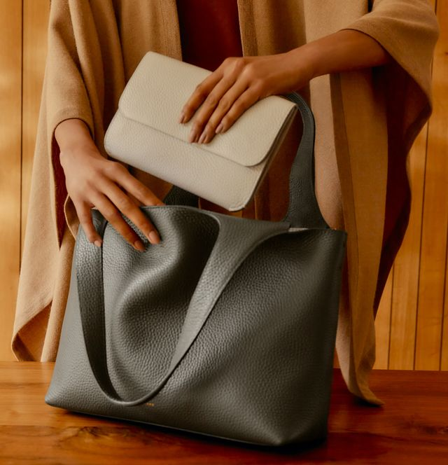 a model opens a cuyana system tote bag