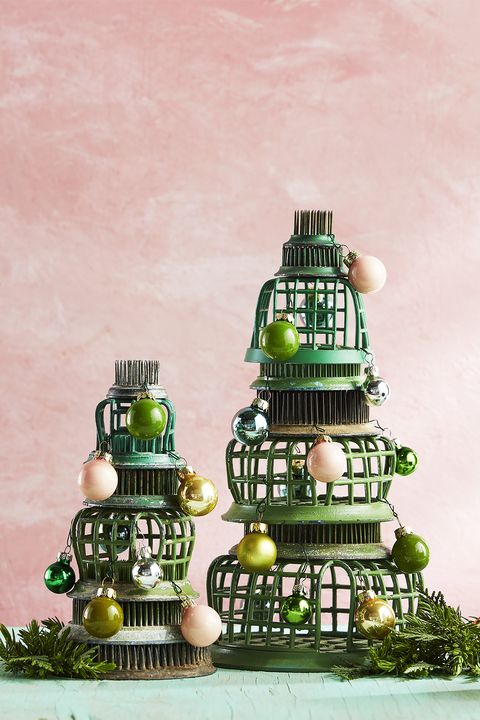 flower frogs stacked in the shape of a tree with tiny ornaments alternative christmas tree