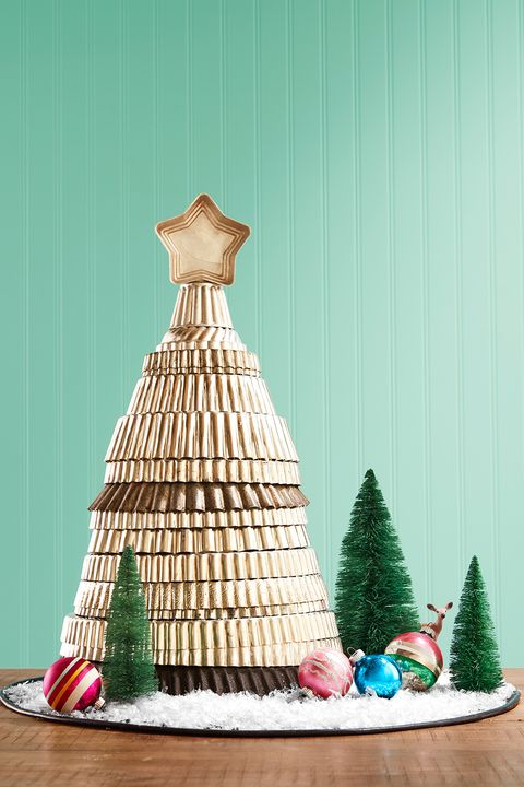 old metal tart pans stacked in the shape of a christmas tree