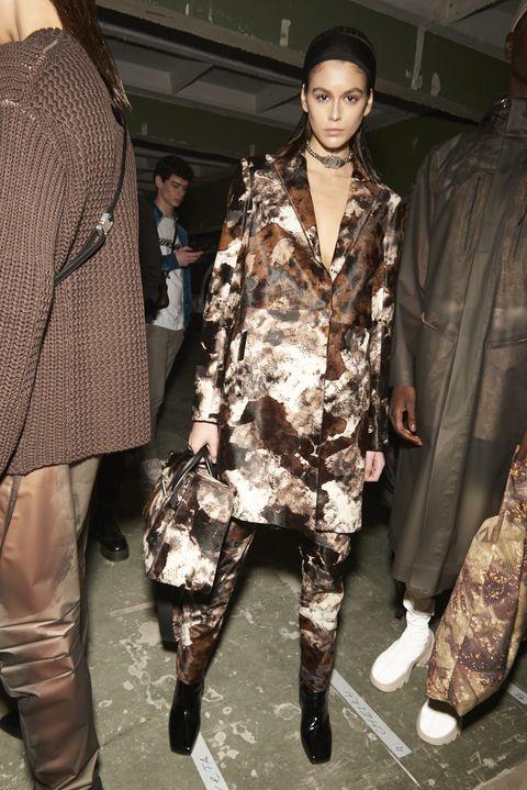 Military camouflage, Clothing, Fashion, Fashion model, Camouflage, Fashion show, Fashion design, Outerwear, Design, Footwear,