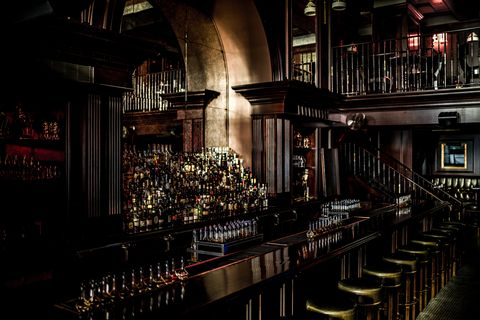 Bar, Building, Pub, Architecture, Tavern, Barware, Interior design, Restaurant, Darkness, City,