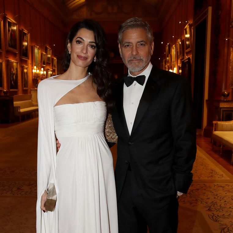 Amal Clooney wows in white for meeting with Prince Charles at Buckingham Palace