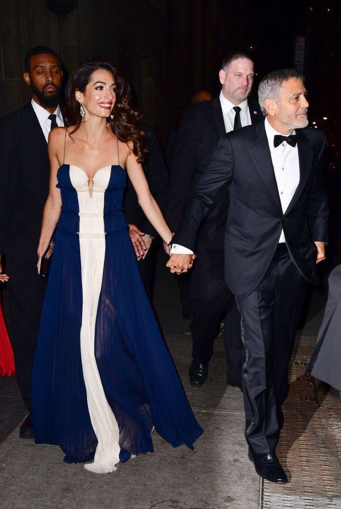 Amal wore a navy and white gown by J. Mendel to the United Nations Correspondents Associations Awards in New York City. The human rights lawyer complimented the dress's sweet-heart neckline with simple accessories of diamond statement earrings and a navy box clutch.