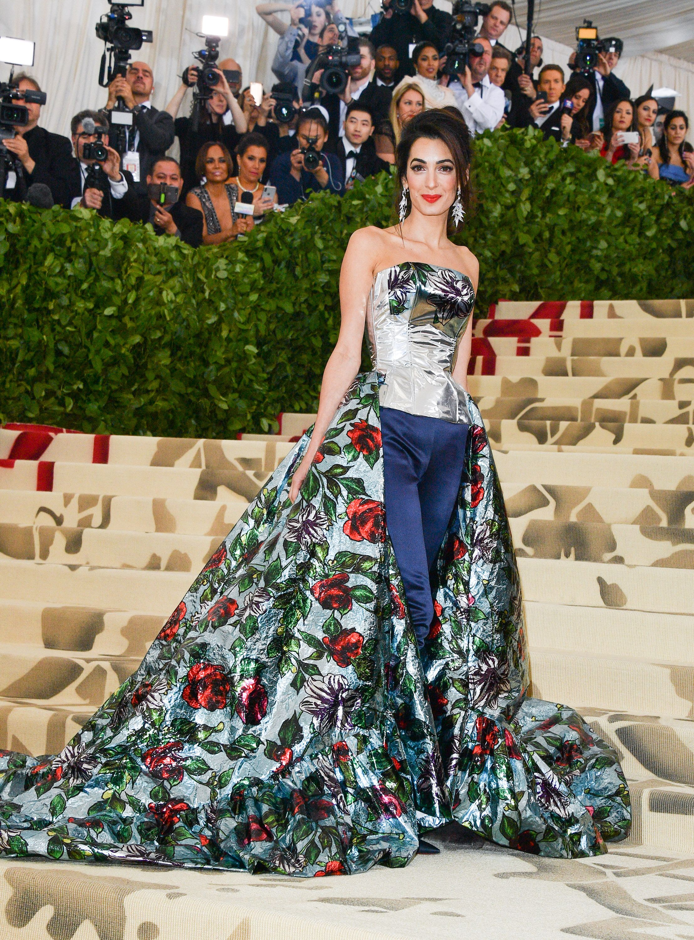 Clooney attended the 2018 Met Gala (for which she was a chairwoman) in a romantic Richard Quinn ensemble that included satin pants and a full rosebud printed skirt