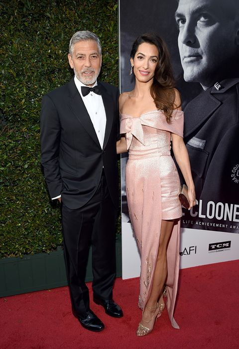 the latest 1fa36 9024c Amal Clooney look: l'abito da sera della moda estate 2018