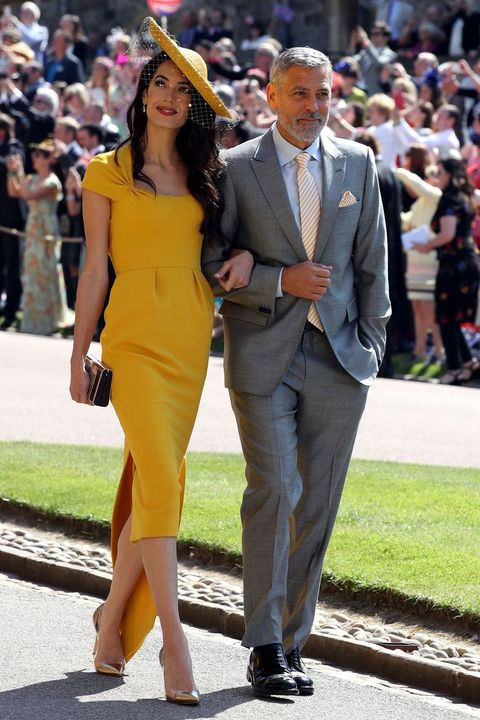 a6b9f999f56 Amal Clooney s Sun Yellow Stella McCartney Royal Wedding Dress Is ...