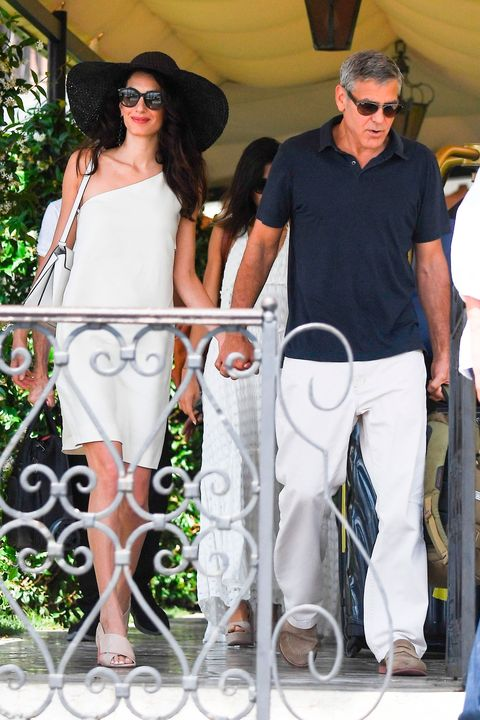 Amal Clooney masters summer style in white dress and sunhat