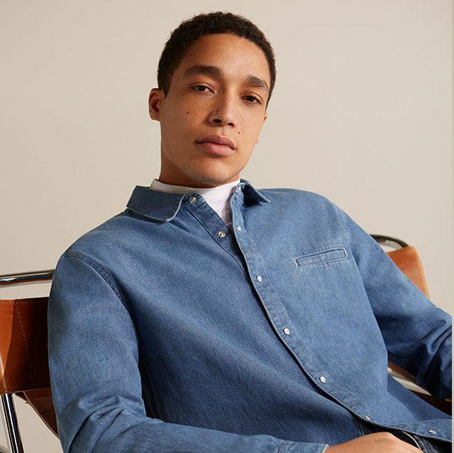 Clothing, Suit, Sitting, Fashion, Standing, White-collar worker, Outerwear, Formal wear, Dress shirt, Fashion design,