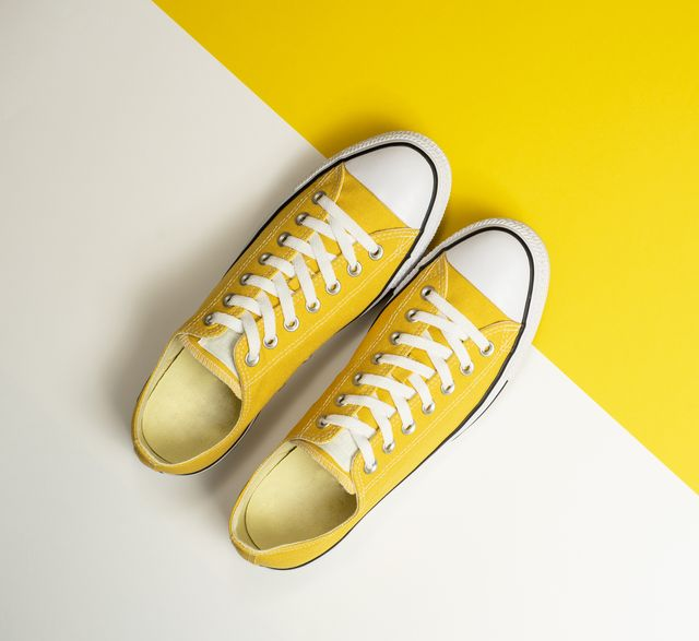 yellow sneakers on a yellow and white background
