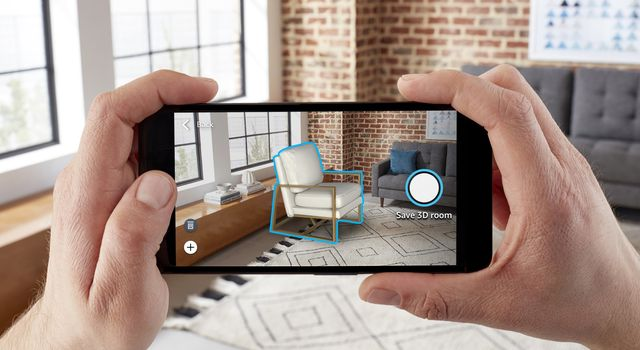 person holding virtually decorating room
