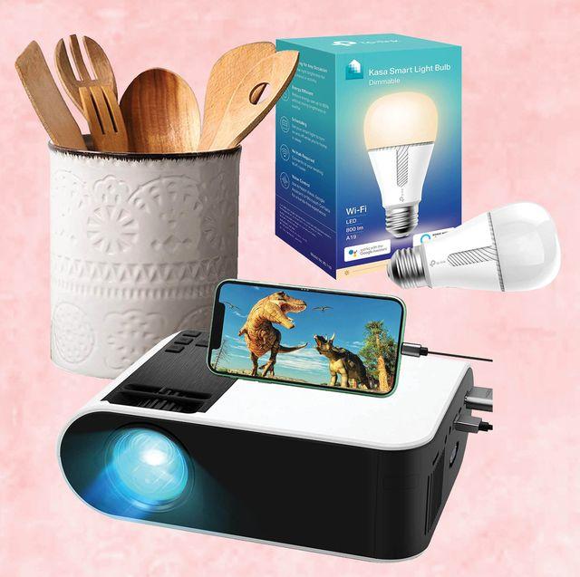 utensil holder, light bulb, projector, pink background