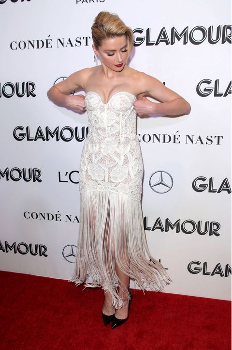 Clothing, Dress, Shoulder, Hairstyle, Carpet, Red carpet, Joint, Premiere, Ringlet, Gown,
