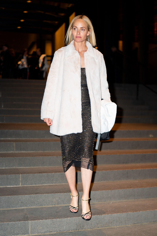 The model wore a gorgeous faux fur coat .