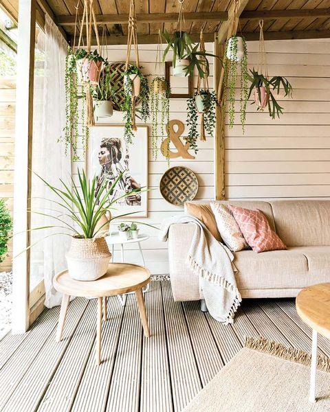 Una casa decorada en tonos pastel: Porche