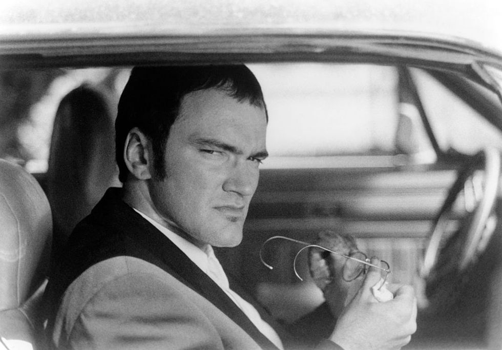 From Dusk Till Dawn (1996) Tarantino cleans his glasses on the set of From Dusk Till Dawn. The film was directed by Robert Rodriguez and written by Tarantino .