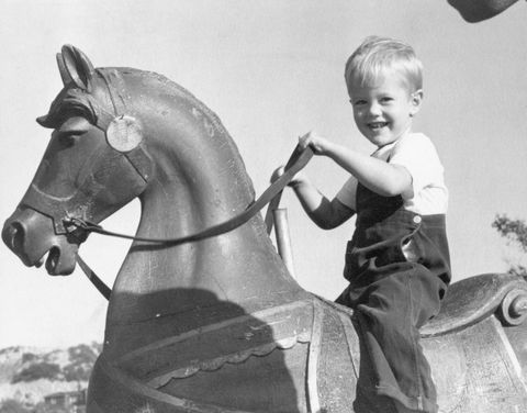 Young Peter Fonda on Rocking Horse