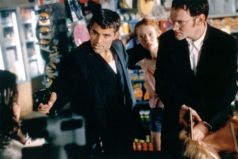 From Dusk Till Dawn (1996) Clooney and Tarantino pull out their guns for a heated scene in From Dusk Till Dawn. The two actors played bank robbers, but the horror action film has a twist.