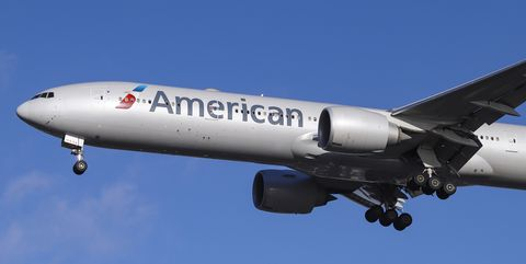 American Airlines Boeing 777-300 with registration N717AN is...