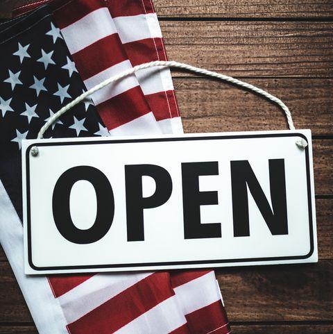 american flag with door open sign