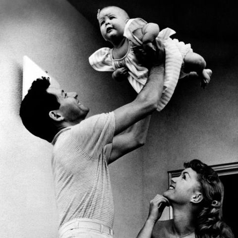 eddie fisher holding carrie fisher in his arms beside debbie reynolds