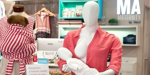 Mannequin, Outerwear, Fashion design, Sleeve, Neck, Retail, Boutique, Display window,