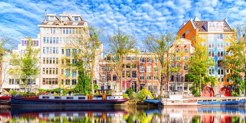 Reflection, Waterway, Water, Town, Architecture, Property, Building, Urban area, Mixed-use, Real estate,