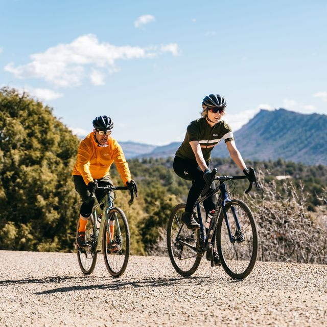 amy colyar and matt phillips on gravel with gravel bikes in colorado